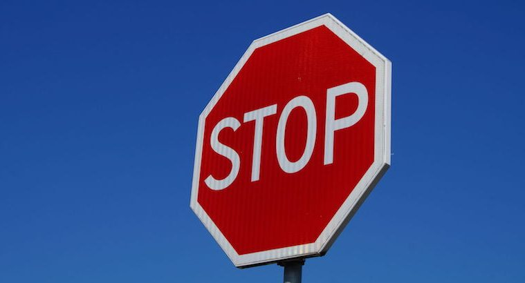 37578445 - stop sign isolated on clean blue sky